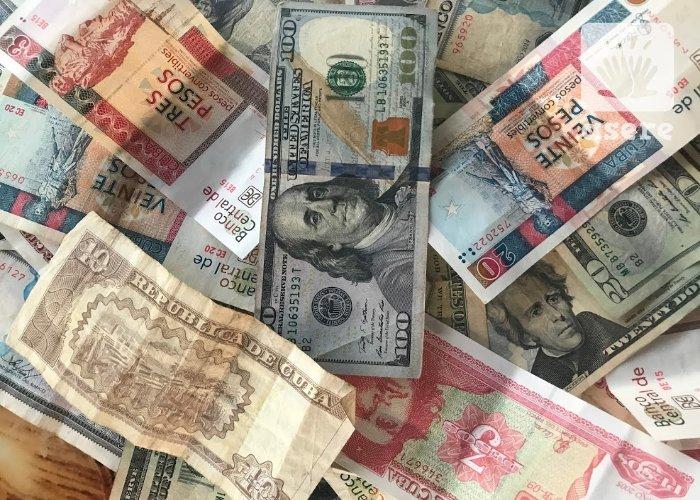 Dólares, pesos cubanos y moneda convertible